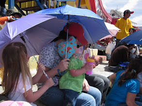 Photo: We bought 3 little umbrellas for the girls.  It was 80*F, plus we were in a packed crowd in a concrete stadium, sitting in the sun.