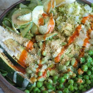 Green Buddha Bowls with Tahini and Vegan Parmesan.