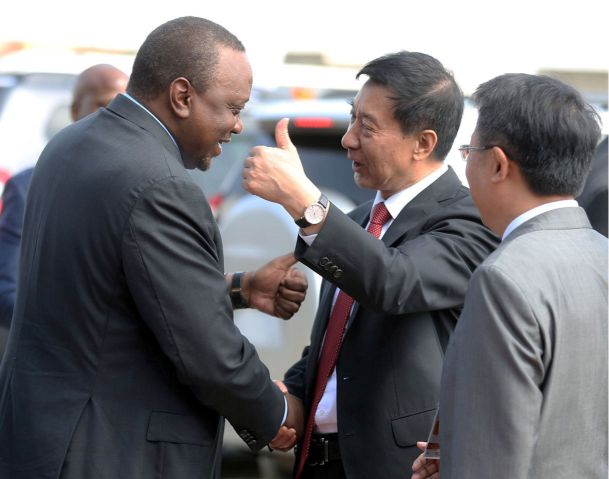 President Uhuru Kenyatta and the special envoy of the Peoples Republic of China Wang Yong exchange pleasantries at the Nairobi SGR Terminus during the launch of the SGR Freight services to the Naivasha Inland Container Depot on December 17, 2019.