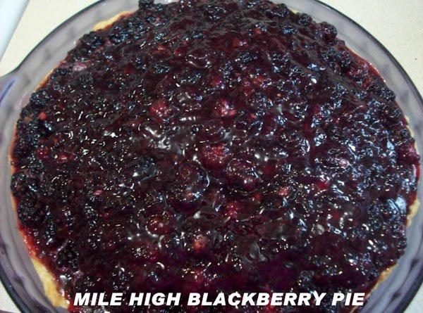 Pour the cooled Jell-O over berries & fold in. Pour into pie shell, piling...