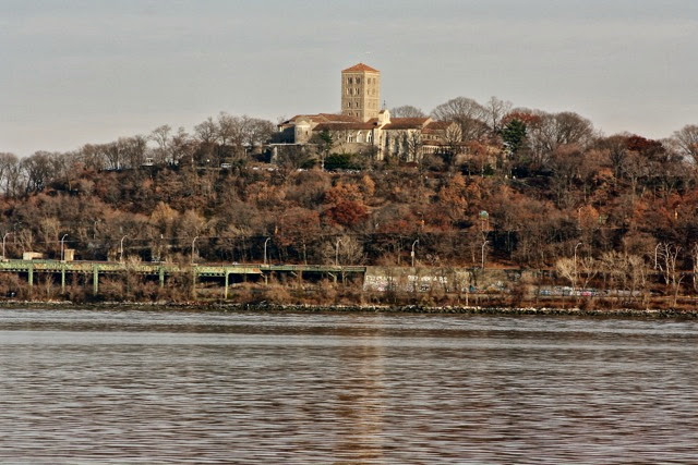 Photo: The Cloisters as seen from the Palisades.  The building, which is a branch of the Metropolitan Museum of Art, was built in the 1930s and resembles architectural elements of several European medieval abbeys.  [ Wikipedia ]  The Hudson River Parkway which leads to Connecticut is visible in the foreground.