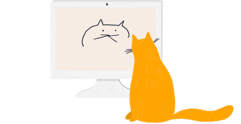A real cat stares at a cat doodle on a computer screen, presumably contemplating its own self-image.