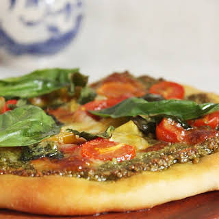 A PESTO PIZZA WITH JAMIE OLIVER'S PIZZA DOUGH.