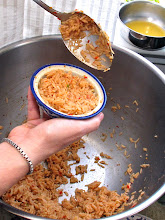 Photo: filling the rice in a small round bowl to invert onto a plate