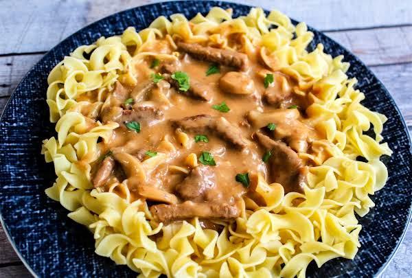 Grandma's Beef Stroganoff Served Over Noodles.