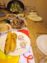 Photo: The feast: freshly caught grilled barracuda, mixed vegetable medley, whiteandpurple potatoes, Venezuelan yam, roastedplantains, roasted garlic