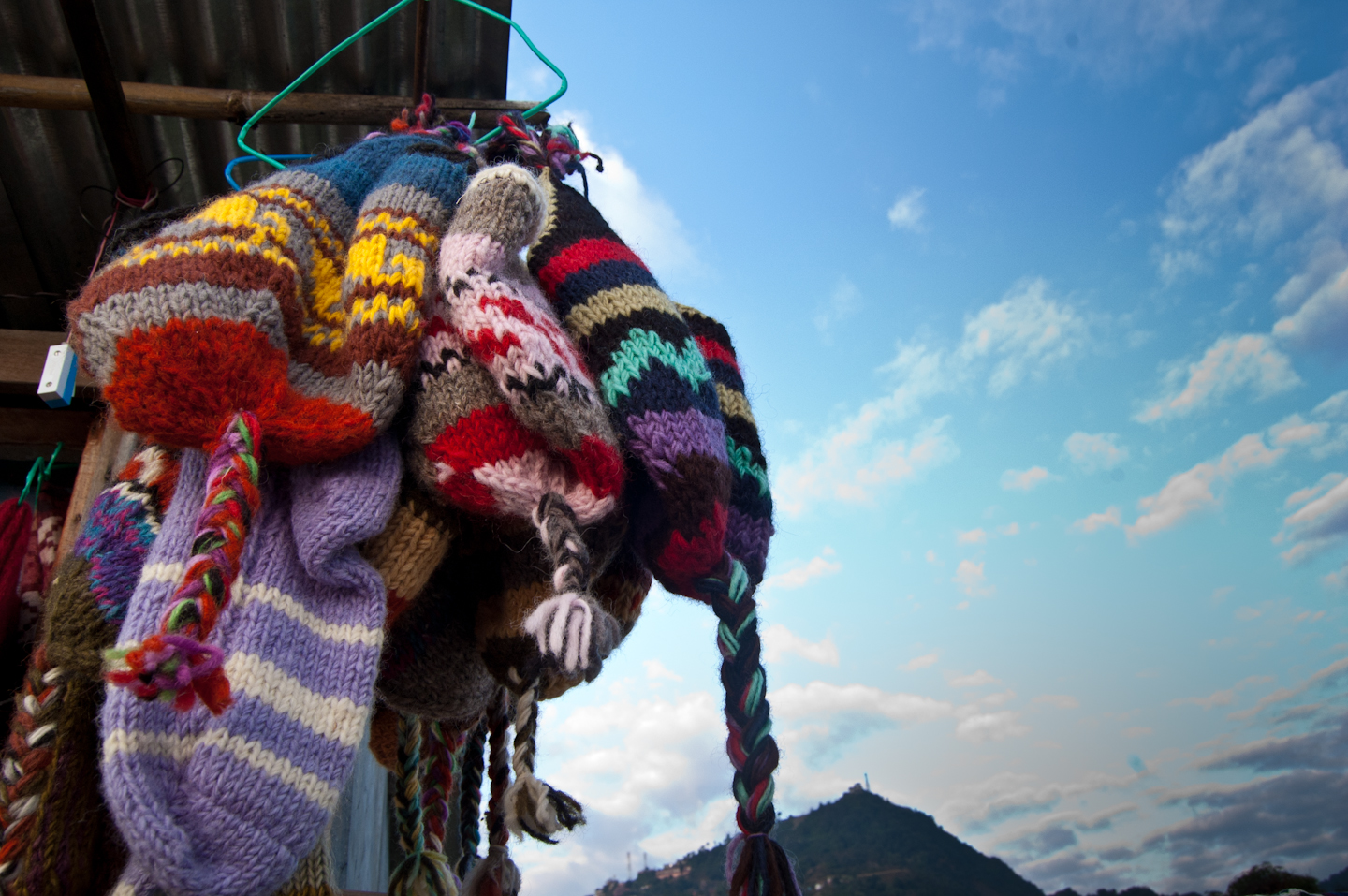 Photo: I'll Keep You Warm  Handicraft woolen caps hanging in a wayside shop near Sarangkot, Pokhara.  Love to shoot these kinda stuff that are mostly seen as commonplace, yet they can surprise you if you give them some time and thought. For #WhateverWednesday curated by +Cicely Robin Laing .
