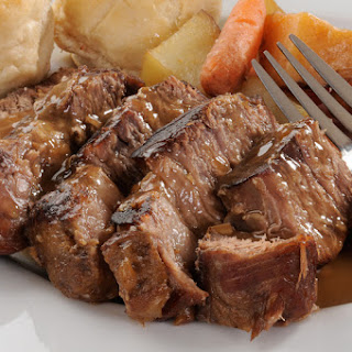 Juicy, Tender & Slow Cooked Roast Beef With Seasoned Vegetables.