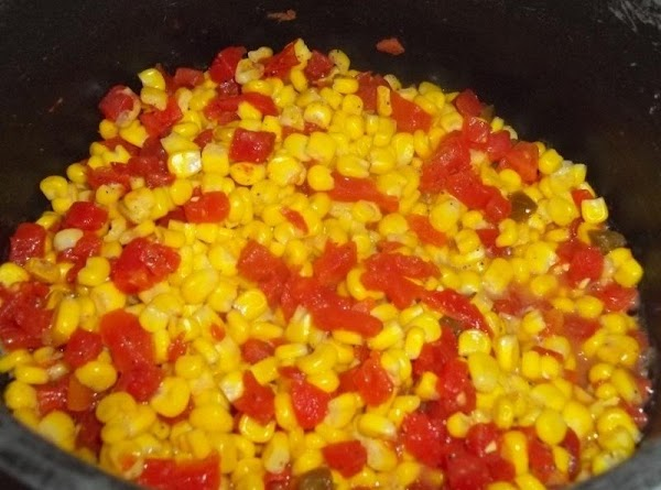 Cook your corn as directed and drain.  Add butter, stir. Salt and pepper. Stir in...
