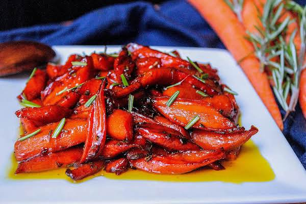 Roasted Glazed Carrots On A Platter With Rosemary.