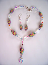 "Photo: PCC- 114 Necklace and earrings set. Polymer Clay cane deads with crystal and glass beads. 18"", $79.00"