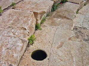 Photo: Rhodiapolis, Theater, hole to support the sunshade .......... Gat in de vloer van het Theater om het zonnescherm te stutten
