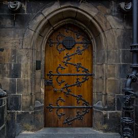 O u r  D o o r by Manu Heiskanen - Uncategorized All Uncategorized ( door, shadow, old, night, black, longesposure, iron, paulinawolekpardon, wood, pipe, sharp, stone )