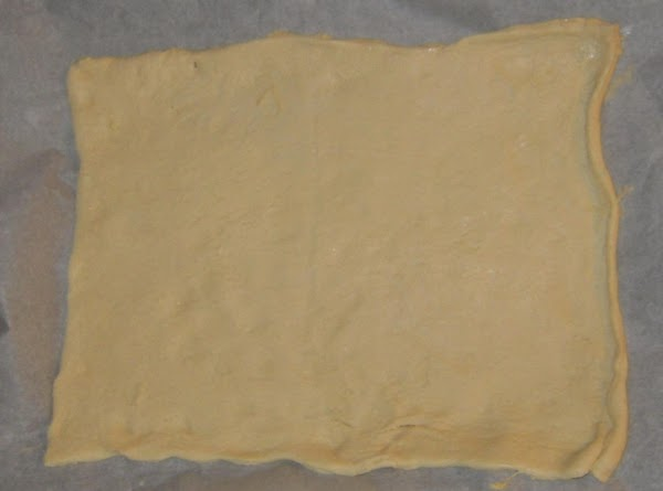Preheat oven to 350'F. Unroll dough onto parchment paper lined cookie sheets, gently stretching dough...