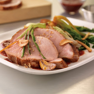 Sous-Vide Pork Loin with Roasted Plum Teriyaki Sauce and Gingered Baby Bok Choy.