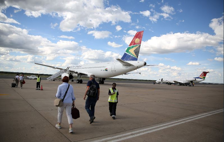 Passengers board a South African Airways aircraft.