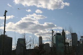 Photo: Kites over the Brooklyn Bridge Park.