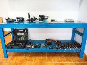 Photo: power tools on table's face, hand tools underneath