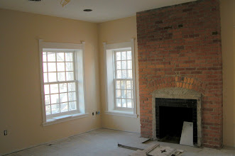 Photo: February 2006 - Month 30: Room 124 - Windows trimmed, walls painted and brick fireplace repointed! Beginning to look like a bedroom.