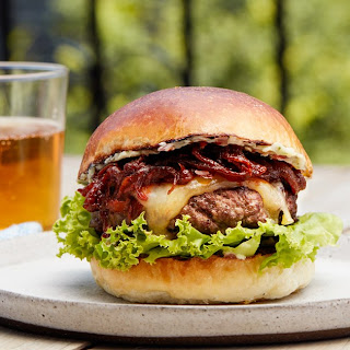 Steakburger With Tangy Caramelized Onions and Herb Butter