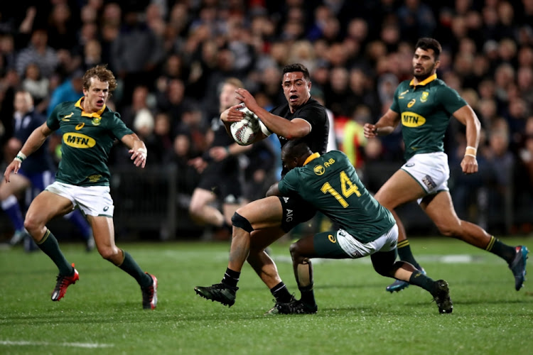 Codie Taylor of the All Blacks is tackled during the Rugby Championship match between the New Zealand All Blacks and the South African Springboks at QBE Stadium on September 16, 2017 in Auckland, New Zealand.