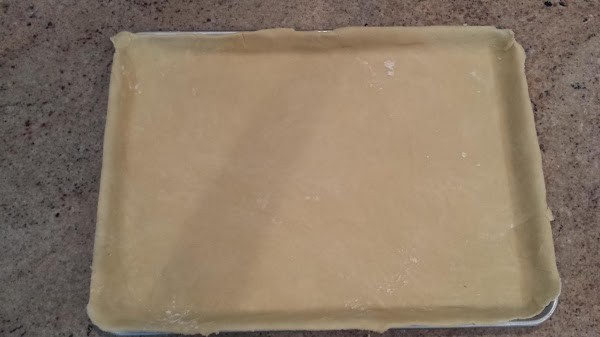 Roll out enough pastry dough big enough to fit a 12x16 inch pan. ...
