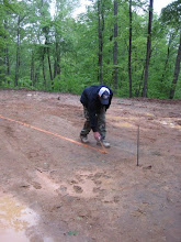 Photo: Sheldon marks out where to dig the foundation. It's a cool, wet, early morning, but we're under way!