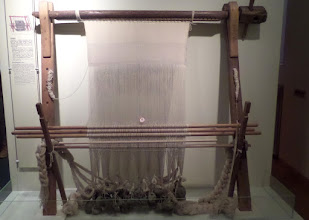 Photo: The warp weighted loom was used in Europe in early times.  It could make twenty inches of fabric in a day.