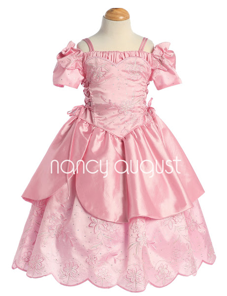 Photo: Little Girls Pink Princess Dress Costume: This pink princess dress is one of the most majestic styles we have ever seen! Constructed with an exquisite rich pink satin, the design of this princess dress is far more detailed than the rest! The bodice is corset-inspired, complete with a darling off the shoulder sleeve and adjustable corset ties down the sides of the torso. The double-layer skirt is full and fancy with fluttering layers and a scalloped hem.