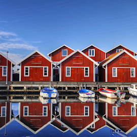Fishermans huts in Sweden by Eva Larsson - Buildings & Architecture Office Buildings & Hotels ( fisherman huts houses boats blue sky reflection peaceful sweden coast still )