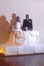 Photo: The happy couple at their table at the reception.