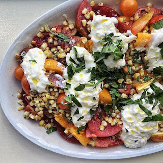 Heirloom Tomato Salad With Blistered Corn, Stracciatella Cheese And Fresh Basil.