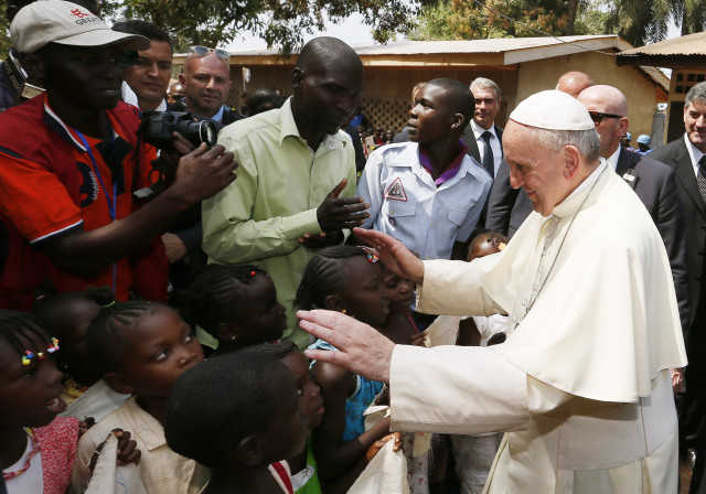 Pope Francis greets children as he visits a refugee camp in Bangui, Central African Republic, Nov. 29. (CNS photo/Paul Haring) See POPE-BANGUI-UNITY Nov. 30, 2015.