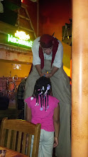 Photo: Kaleya tells the guy on stilts the details of what she wants