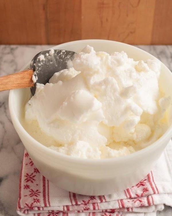 Fold the egg whites into the eggnog: Transfer the beaten egg whites to the...
