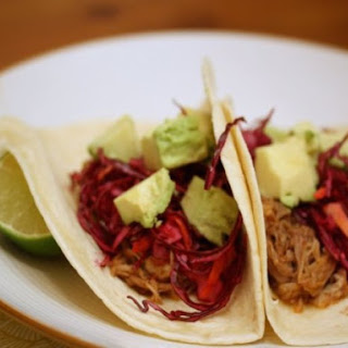 Easy Slow-Cooker Pork Tacos with Red Cabbage Crunch and Avocado.