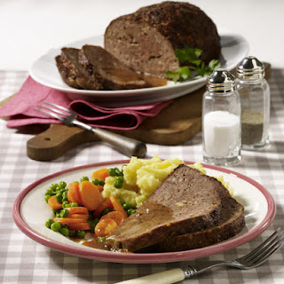 Meatloaf and Mashed Potatoes with Peas and Carrots.