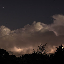Storm in The Distance by Thomas Shaw - Landscapes Cloud Formations ( clouds, lightning, clayton, sky, blue, white, trees, night, north caroina, storm, black, nightscape )