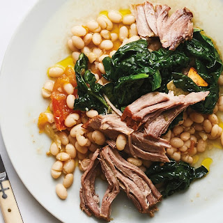 Slow-Cooked Pork Shoulder with Braised White Beans recipe | Epicurious.com.