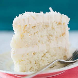Coconut-Vanilla Bean Cake with Coconut Meringue Buttercream Frosting.