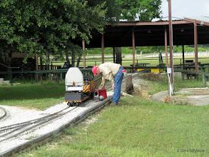 Photo: Bob Barnett, getting gasoline for his loco.   HALS Public Run Day  2016-0716  RPWhite
