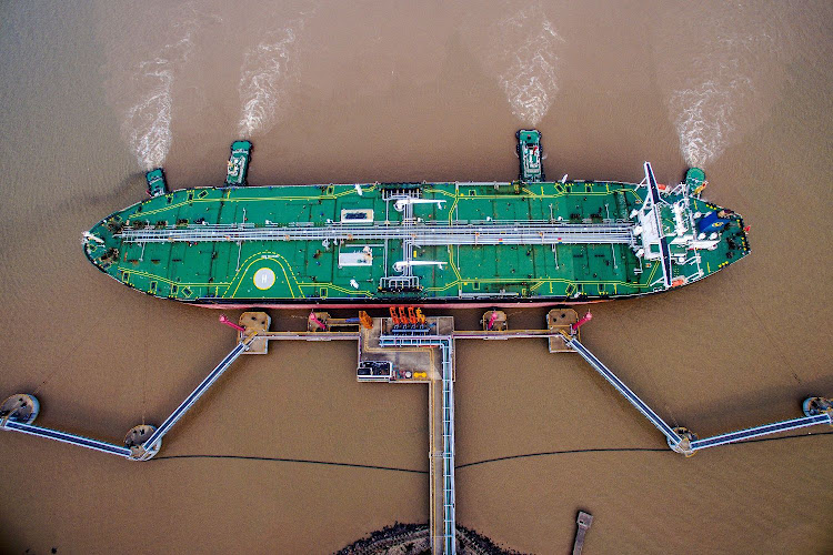 An oil tanker unloads crude oil at a crude oil terminal in Zhoushan, Zhejiang province, China. Picture: REUTERS/STRINGER/CHINA OUT