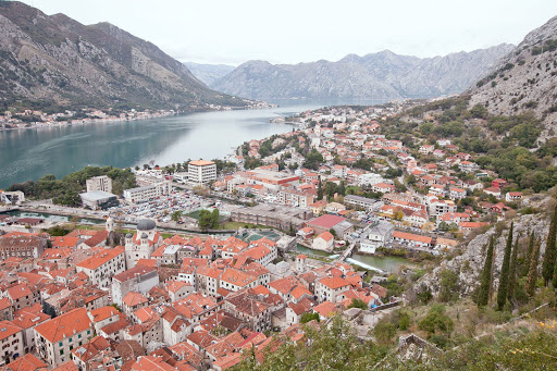 Kotor-overlooka.jpg - A grand overlook of Kotor and its iconic orange-roofed buildings as seen from two-thirds up the Ladder of Kotor trail.