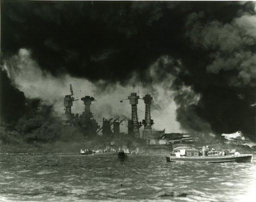 The USS West Virginia BB-48 and the USS Tennessee BB-43 after the Japanese attack on Pearl Harbor