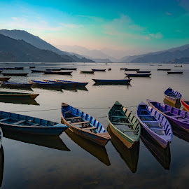 Pokhara Boats by Christopher Pearce - Transportation Boats ( boats, river, clouds, water )