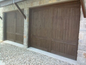 Photo: Two 9'W X 8'H doors fill up almost the entire front wall of the garage. Note how small the center post between the doors is to allow for the larger door size. They are even tighter on the outside edges, within 6 inches.