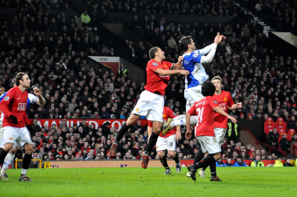 Manchester United's Vidic jumping for header (Heading A Soccer Ball)