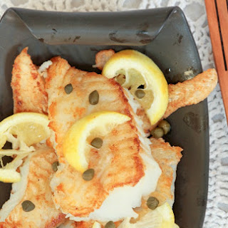 Crispy Cod with Lemon Butter White Wine Sauce.