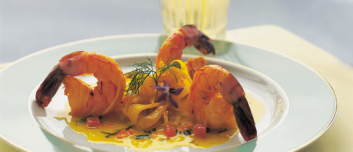 Crystal-EspritR-dining - The dining room on Crystal Esprit serves classics such as Excabeche of Prawns with braised saffron fennel.