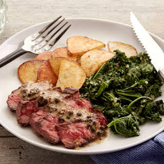 Steaks & Green Peppercorn Sauce with Kale & Roasted Potato.